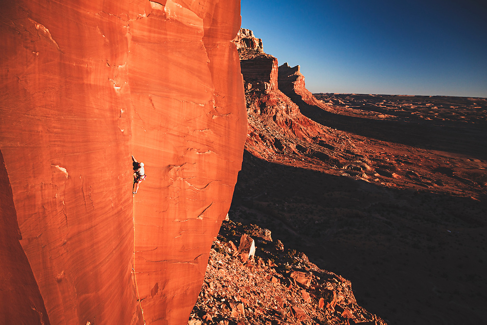 """Blood on the Tracks"" 5.12b, Mike Friedrichs, the  first ascentionist, takes a lap, Dylan Wall, San Rafael Swell, Utah."