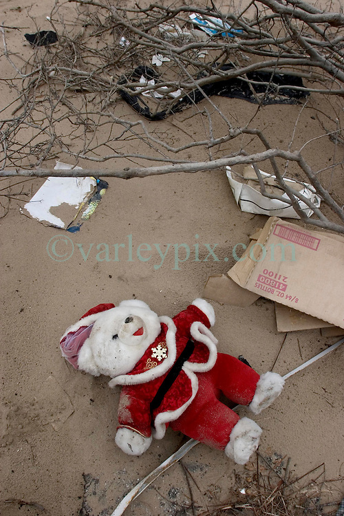 10, December 05. New Orleans, Louisiana. Post Katrina aftermath.<br />  A discarded Christmas teddy bear lies in the dirt in the Gentilly neighbourhood where is washed up following hurricane Katrina.<br /> Photo; &copy;Charlie Varley/varleypix.com