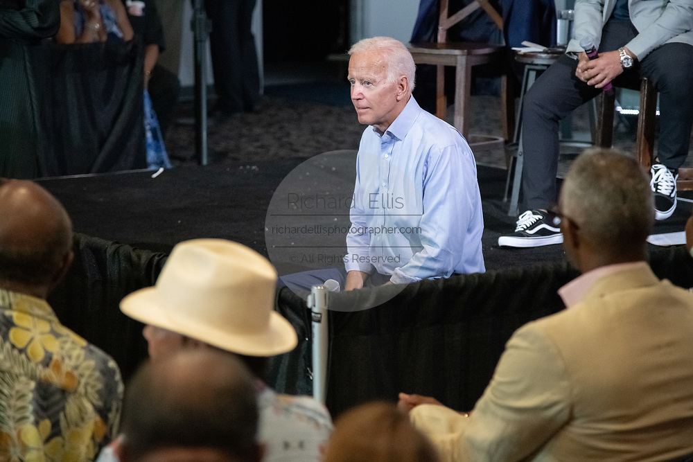 Former Vice President Joe Biden listens to an audience question during a town hall meeting at the International Longshoreman's Association Hall July 7, 2019 in Charleston, South Carolina.