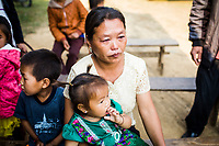 Siyang Wathaoyang and her young daughter at the JE vaccination campaign in Khon Kahndone Village, Xieng Khouang province, Laos.