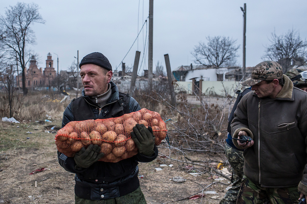 PISKY, UKRAINE - NOVEMBER 17, 2014: Pro-Ukraine militia members take a delivery of potatoes to their camp, from which they fight against pro-Russia rebels for control of the Donetsk airport, in Pisky, Ukraine. CREDIT: Brendan Hoffman for The New York Times