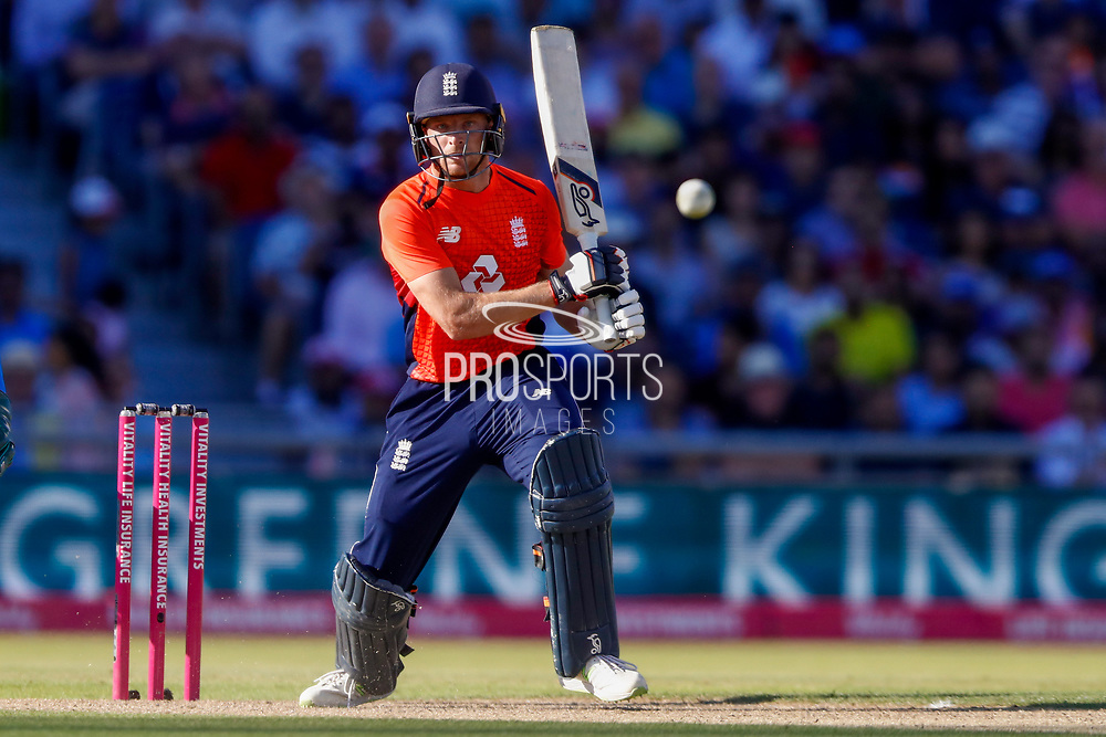 England T20 wicket keeper Jos Butler hits a single to mid off during the International T20 match between England and India at Old Trafford, Manchester, England on 3 July 2018. Picture by Simon Davies.