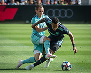 Seattle Sounders forward Harrison Shipp (19) takes down LAFC midfielder Mark-Anthony Kaye (14) during a MLS soccer match in Los Angeles, Sunday, April 21, 2019. LAFC defeated the Sounders 4-1. (Ed Ruvalcaba/Image of Sport)