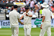 Sam Curran of England is congratulated on his bowling performance by Ben Stokes of England as he walk off for lunch during second day of the Specsavers International Test Match 2018 match between England and India at Edgbaston, Birmingham, United Kingdom on 2 August 2018. Picture by Graham Hunt.