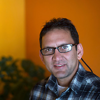 Ramesh Poudel, owner of Himalayan Grill in Flagstaff, poses for a photo inside his restaurant Thursday.