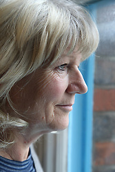 White woman looking out of window