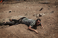 A Palestinian screams in pain as he has just been hit by a sniper bullet in his right leg at the border fence with Israel as mass demonstrations continue on May 14, 2018 in Gaza City, Gaza. Israeli soldiers killed at least 41 Palestinians and wounded over a thousand as the demonstrations coincided with the controversial opening of the U.S. Embassy in Jerusalem. This marks the deadliest day of violence in Gaza since 2014. Gaza's Hamas rulers have vowed that the marches will continue until the decade-old Israeli blockade of the territory is lifted