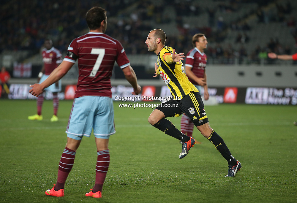 Phoenix captain Andrew Durante, celebrates his goal during the Wellington Phoenix vs West Ham United football match played at Eden Park in Auckland on 23 July 2014. <br /> Credit; Peter Meecham/ www.photosport.co.nz
