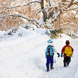 A young boy (age 5) and his sister (age 7) walk to school on a winter morning in Portsmouth, New Hampshire.