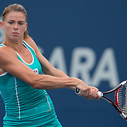 August 16, 2014, New Haven, CT:<br /> Camila Giorgi hits a backhand during a match against Coco Vandeweghe on day three of the 2014 Connecticut Open at the Yale University Tennis Center in New Haven, Connecticut Sunday, August 17, 2014.<br /> (Photo by Billie Weiss/Connecticut Open)