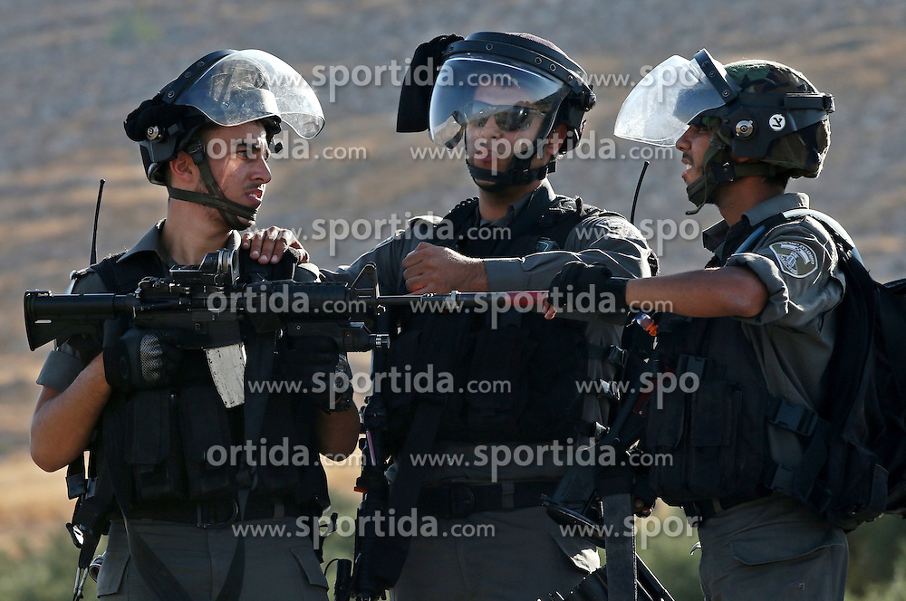 08.08.2015, Duma, PSE, Nahostkonflikt zwischen Israel und Pal&auml;stina, im Bild Israelische Sicherheitskr&auml;fte // Israeli security forces take position during clashes with Palestinian protesters on a street leading to Duma village, in a demonstration following the funeral of Saad Dawabsha, the father of a Palestinian toddler killed last week when their home was firebombed by Jewish extremists, near the West Bank city of Nablus. Dawabsha succumbed in hospital in the southern Israeli city of Beersheba where he was being treated for third degree burns while his wife Riham and four-year-old son Ahmed are still fighting for their lives, Palestine on 2015/08/08. EXPA Pictures &copy; 2015, PhotoCredit: EXPA/ APAimages/ Ahmad Talat<br /> <br /> *****ATTENTION - for AUT, GER, SUI, ITA, POL, CRO, SRB only*****