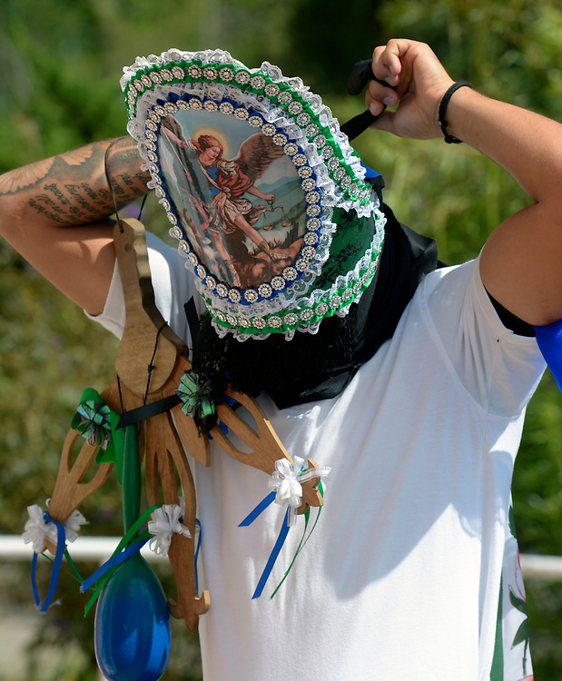 gbs081017a/RIO-WEST -- Tristin Longley ties on his cupil with the help of Frances Garcia before the procession during Las Fiestas de San Lorenzo on Thursday, August 10, 2017.(Greg Sorber/Albuquerque Journal)