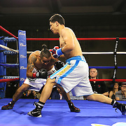Zhankizh Turatov of Almaty, Kazakhstan (R) punches Gustavo Garibay of Mexico during a Nelsons Promotions boxing match at the Boca Raton Resort  and Club on Friday, May 26, 2017 in Boca Raton, Florida.  (Alex Menendez via AP)