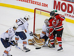 Nov 9, 2008; Newark, NJ, USA; New Jersey Devils right wing Jamie Langenbrunner (15) tries to tip a shot by Edmonton Oilers goalie Jeff Drouin-Deslauriers (38) while Edmonton Oilers defenseman Tom Gilbert (77) and Edmonton Oilers center Andrew Cogliano (13) defend during the second period at the Prudential Center.