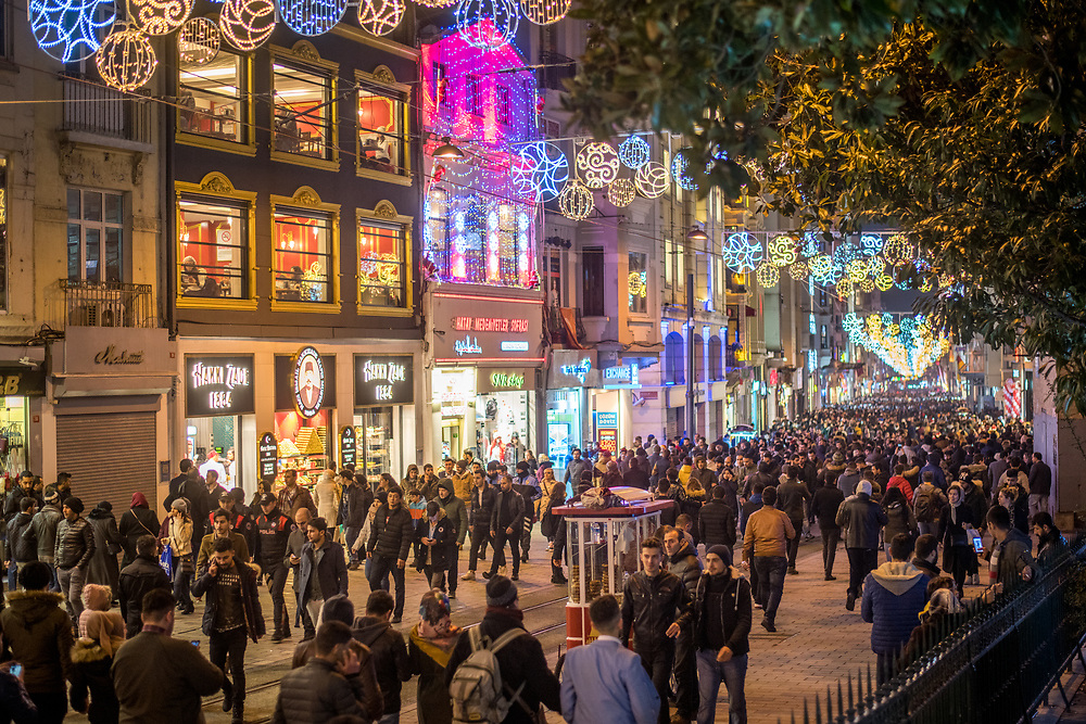 Droves of people navigate the bright and busy streets of Istanbul, Turkey