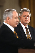 US President Bill Clinton looks toward Israeli Prime Minister Benjamin Netanyahu during a joint press conference February 13, 1997 In Washington, DC.