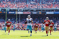 September 18, 2011; San Francisco, CA, USA; Dallas Cowboys wide receiver Miles Austin (19) rushes past San Francisco 49ers defensive back Reggie Smith (30) and cornerback Carlos Rogers (22) after a pass reception to score a touchdown during the second quarter at Candlestick Park.