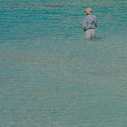Man fishing at North beach, Isla Mujeres, Quintana Roo. MX.