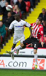 SHEFFIELD, ENGLAND - Saturday, March 17, 2012: Tranmere Rovers' Zoumana Bakayogo in action against Sheffield United's Matthew Lowton during the Football League One match at Bramall Lane. (Pic by David Rawcliffe/Propaganda)