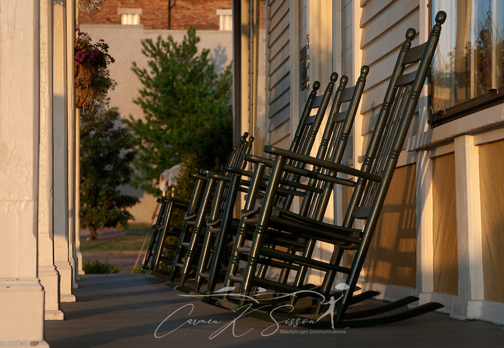 The sun sets on a row of rocking chairs at Tennessee Williams Welcome Center in Columbus, Miss. The Welcome Center is located in the house where the Pulitzer Prize-winning playwright was born in 1911. (Photo by Carmen K. Sisson/Cloudybright)