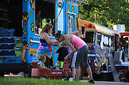 People gather on a summer evening in Jefferson Barracks Park for one of the many Food Truck Fest events sponsored throughout summer by St. Louis County Parks; St. Louis, MO