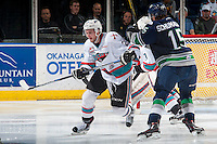 KELOWNA, CANADA - APRIL 23: Andreas Schumacher #15 of Seattle Thunderbirds checks Cole Linaker #26 of Kelowna Rockets during second period on April 23, 2016 at Prospera Place in Kelowna, British Columbia, Canada.  (Photo by Marissa Baecker/Shoot the Breeze)  *** Local Caption *** Andreas Schumacher; Cole Linaker;