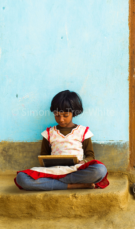 8th February 2012, a girl with a chalk board in<br />  Dhanawa Village, Bodh Gaya, Bihar. <br /> <br /> <br /> PRACHAR stands for Promoting Change in Reproductive Behaviour, focussing on improving women's health through various initiatives like delaying childbirth, family planning, hygiene<br /> <br /> PHOTOGRAPH BY AND COPYRIGHT OF SIMON DE TREY-WHITE<br /> <br /> + 91 98103 99809<br /> + 91 11 435 06980<br /> +44 07966 405896<br /> +44 1963 220 745<br /> email: simon@simondetreywhite.com photographer in delhi
