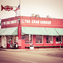 Crab Cooker Newport Beach vintage photo. The Crab Cooker is a popular landmark restaurant on Balboa Peninsula in Newport Beach, Orange County, California.  The Crab Cooker was originally a bank and was converted into a seafood restaurant. The photo has a vintage tone applied to give an aged Instagram look.
