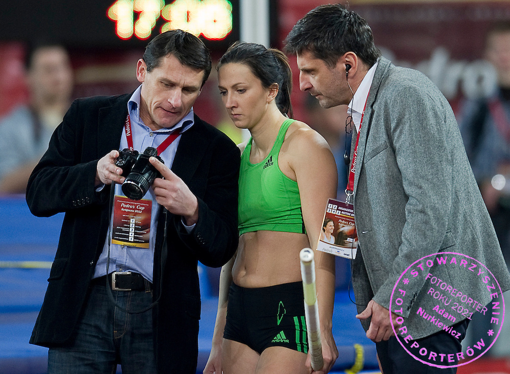 (L) Trainer coach Wiaczeslaw Kaliniczenko of Monika Pyrek of Poland and Monika Pyrek of Poland and (R) Norbert Rokita her husband during indoor athletics meeting Pedro's Cup 2012 at Luczniczka Hall in Bydgoszcz, Poland.<br /> <br /> Poland, Bydgoszcz, February 8, 2012.<br /> <br /> Picture also available in RAW (NEF) or TIFF format on special request.<br /> <br /> For editorial use only. Any commercial or promotional use requires permission.<br /> <br /> Mandatory credit:<br /> Photo by &copy; Adam Nurkiewicz / Mediasport