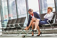 Portrait of young attractive airport staffs talking and sitting while on break in airport