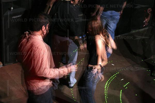 Pakistani young couples enjoy and drinking alcohol during the rave party on Friday 23, 2007 in Karachi, Pakistan..Pakistan most known as an Islamic Taliban and lake of tolerant, certain youths from the middle class and upper class is finding its way out, one foot in tradition and the other in western way of life.