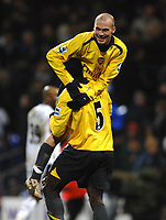 Photo: Paul Greenwood.<br />Bolton Wanderers v Arsenal. The FA Cup. 14/02/2007. Arsenals Freddie Ljungberg and Kolo Toure celebrate at the final whistle