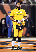 """Pittsburgh Steelers defensive end Cameron Heyward (97) puts on his gloves while wearing a """"just do it"""" shirt before the NFL AFC Wild Card playoff football game against the Cincinnati Bengals on Saturday, Jan. 9, 2016 in Cincinnati. The Steelers won the game 18-16. (©Paul Anthony Spinelli)"""