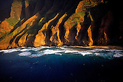 Aerial image of the Na Pali Cliffs at sunset in Kauai, Hawaii, Hawaiian Islands