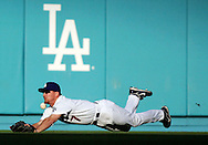 The Los Angeles Dodgers' J.D. Drew gets a chin-ful when he can't come up with the catch on a Carlos Beltran single to right center during the first inning of Game 3 of the National League Division Series at Dodger Stadium in Los Angeles, CA Saturday October 7, 2006.