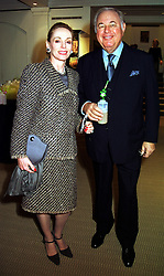 MR & MRS ALFRED TAUBMANN owner of Sotheby's, at a dinner in London on 26th October 1999.MYE 2