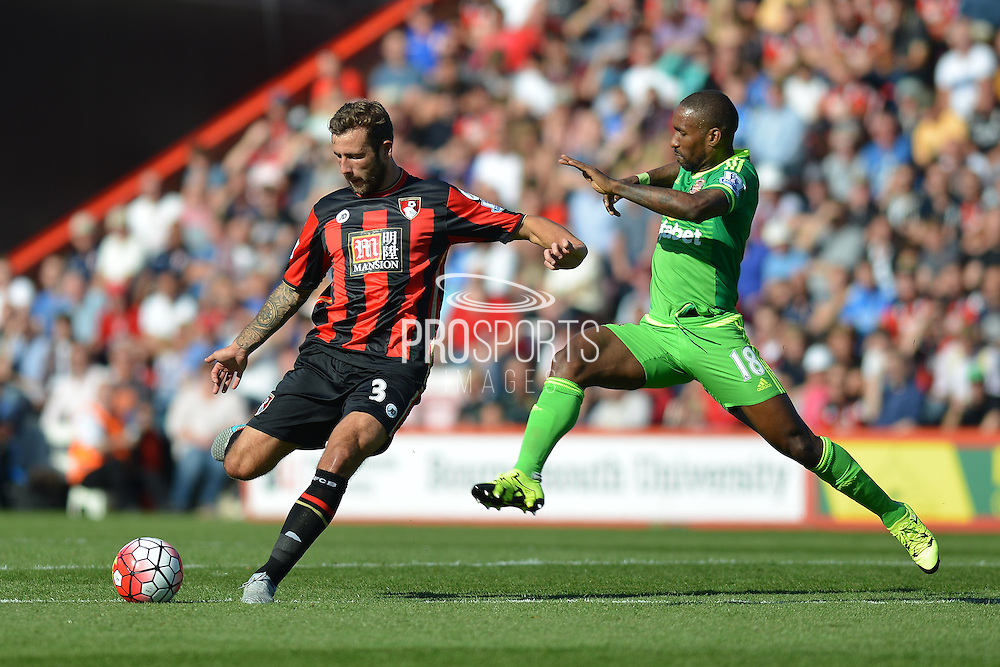 AFC Bournemouth's defender Steve Cook passes the ball upfield in front of Sunderland AFC striker Jermain Defoe during the Barclays Premier League match between Bournemouth and Sunderland at the Goldsands Stadium, Bournemouth, England on 19 September 2015. Photo by Mark Davies.