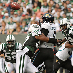Nov 15, 2009; East Rutherford, NJ, USA; New York Jets linebacker Calvin Pace (97) sacks Jacksonville Jaguars quarterback David Garrard (9) during first half NFL action between the New York Jets and Jacksonville Jaguars at Giants Stadium.