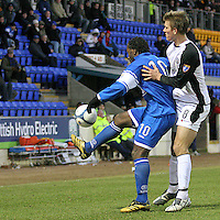 St Johnstone's Jason Scotland and Gretna's Eric Paartalu in action. Scottish First Division match, McDiarmid Park Perth 27th January 2007..
