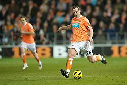 BLACKPOOL, ENGLAND - Tuesday, January 25, 2011: Blackpool's Charlie Adam in action against Manchester United during the Premiership match at Bloomfield Road. (Photo by David Rawcliffe/Propaganda)
