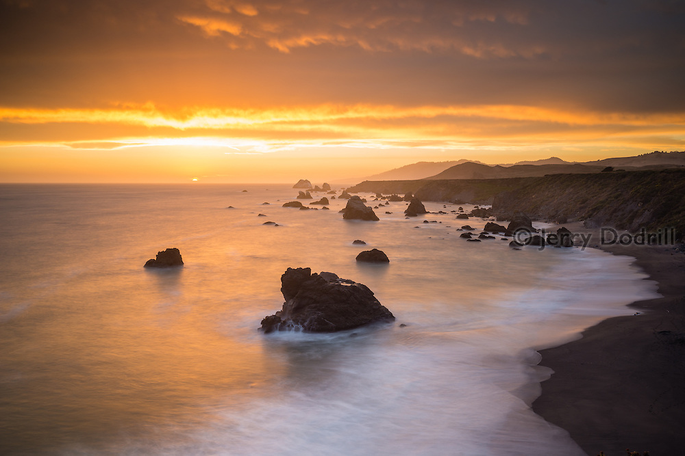 Stormy summer sunset at Furlong Gulch, Sonoma Coast State Park, near Jenner, California