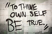 "graffiti in New Orleans; ""To thine own self be true."""