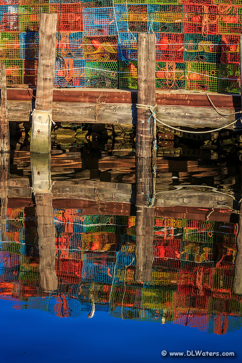 Colorful crab traps stacked on the dock at Wancheese on the Outer Banks of NC.