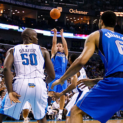 November 17, 2010; New Orleans, LA, USA; Dallas Mavericks point guard Jose Juan Barea (11) shoots against the New Orleans Hornets during the first half at the New Orleans Arena. Mandatory Credit: Derick E. Hingle
