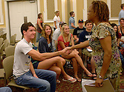 Ohio University freshman Tom Lynch (left) shakes hands with Professor Eddith Dashiell during the Learning Communities Meeting Sunday evening in the Baker Hall Ballroom.