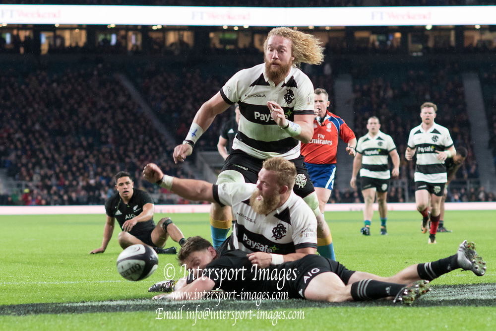 Twickenham, Surrey. England.  Akker van der MERWE and Willie BRITZ chasing the last baal as Beauden BARRETT. loses the ball,  during the Killik Cup, Barbarians vs New Zealand. Twickenham. UK<br /> <br /> Saturday  04.11.17<br /> <br /> [Mandatory Credit Peter SPURRIER/Intersport Images]