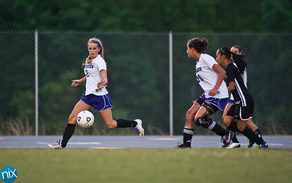 Cox Mill's Ashley MacCoy moves gets control of the ball against West Iredell during the first round of the NCHSAA playoffs Wednesday night in Concord. Cox MIll won the game 3-0. (Photo by James Nix)