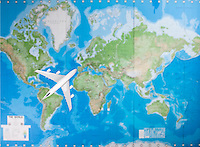 Model aircraft flying over world map