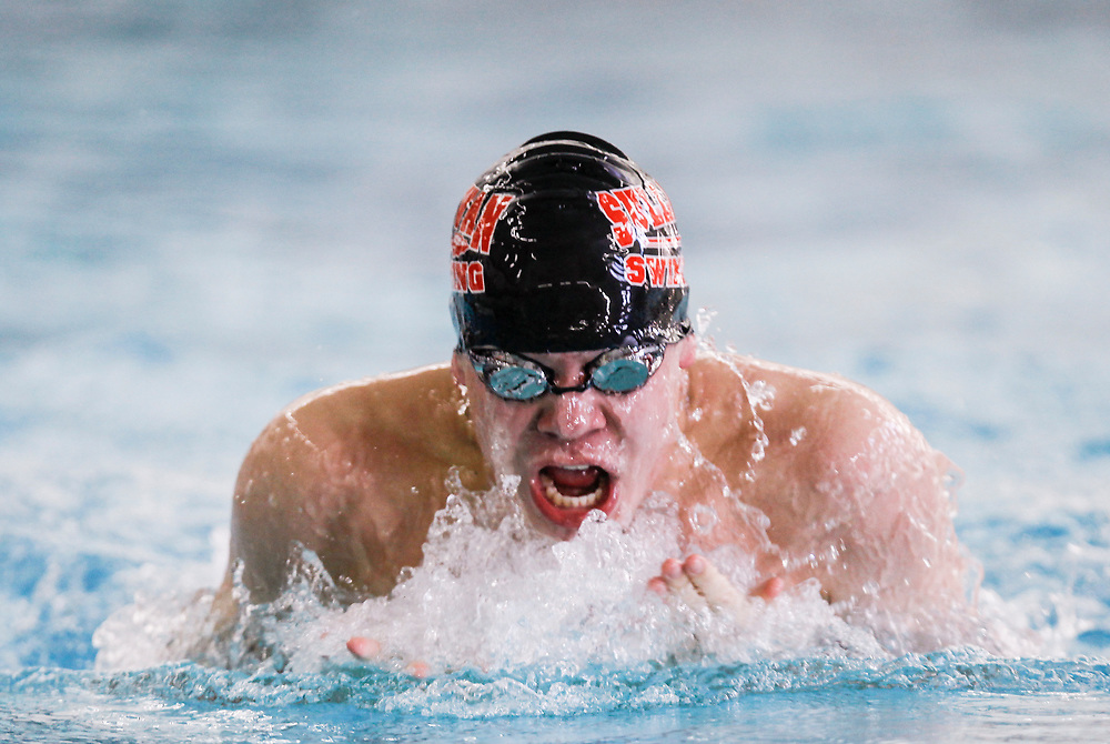 Stephen Haas/ For the News-Gazette<br /> Sullivan's Sam Rousser comes up for air while competing in the 100-yard breaststroke event during an IHSA sectional championship at Centennial High School Saturday, Feb. 16, 2013 in Champaign, Ill.