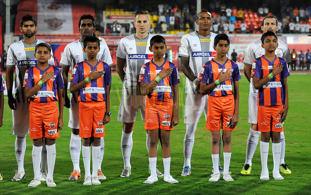 Players from Atletico de Kolkata during the national anthem before the start of match 44 of the Hero Indian Super League between FC Pune City and Atletico de Kolkata FC held at the Shree Shiv Chhatrapati Sports Complex Stadium, Pune, India on the 29th November 2014.<br /> <br /> Photo by:  Pal Pillai/ ISL/ SPORTZPICS